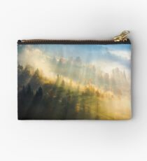 fog over the forest in morning light  Studio Pouch