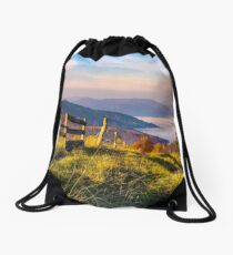beautiful mountainous landscape with wooden fence Drawstring Bag
