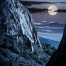 cliffs of Trascau mountains canyon at night by mike-pellinni