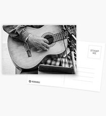 Street guitarist plays classical guitar black and white photo Postcards