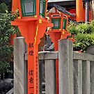 Orange Lanterns And Stone Fence by phil decocco