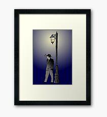 Detective under street lamp Framed Print