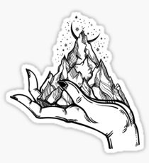 Mountains in hands, tattoo. Wilderness on a palm. Symbol of travel, tourism, meditation t-shirt design, surreal graphics. Sticker