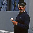 Mykonos sailor with ice cream cone by milton ginos