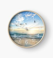 Sunny peaceful beach with birds flying on white sand Clock