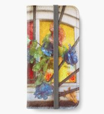 Fake flowers against multicolored glass iPhone Wallet/Case/Skin