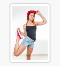 Flexible female teen with red baseball cap wearing black top  Sticker