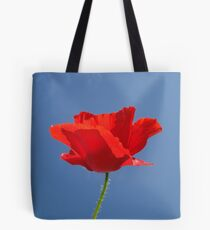 Red Against Blue Tote Bag