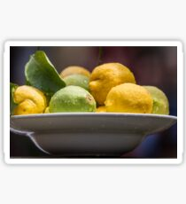 A plate with Fresh Lemons and limes with dew drops  Sticker