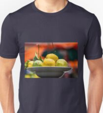 A plate with Fresh Lemons and limes with dew drops  Unisex T-Shirt