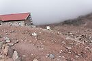 Mountain cabin on misty hillside, Mount Chimborazo, Ecuador by Kendall Anderson