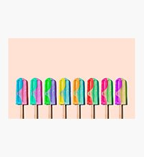 Row of rainbow-colored icecream lollies Photographic Print