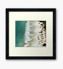 Umbrellas by the Sea Framed Print