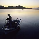 Fisherman early morning Crete, Greece by milton ginos
