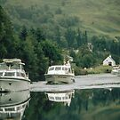 Boats leaving Cullochy Lock S fort Augustus on Caledonian Canal Scotland 19840912 0012  by Fred Mitchell