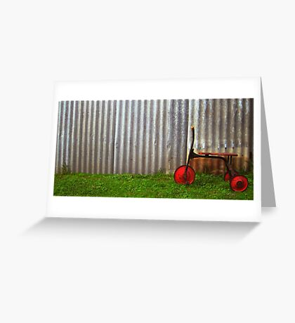 Red trike reminiscing of simpler times... Greeting Card