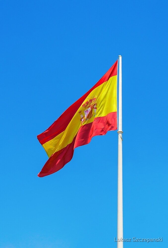 Spanish flag waving against clear blue sky by Lukasz Szczepanski