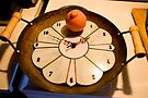 A Clock Wok Orange by Mike Oxley