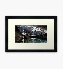 Dinosaur on a lake Framed Print