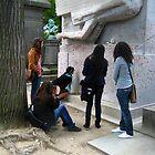 Kissing Oscar Wilde's Gravestone in Paris by Keith Richardson
