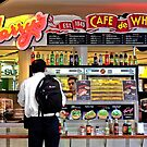Picturing the store owner: Harry's Cafe de Wheels, Sydney Airport by Vanessa Pike-Russell