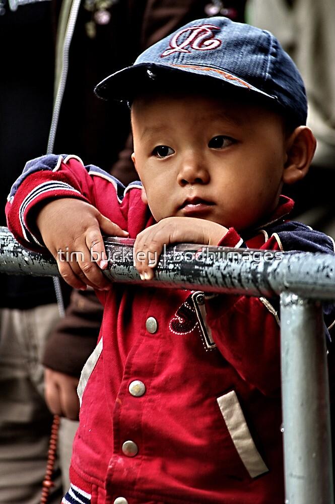tibetan boy. mcleod ganj, india by tim buckley | bodhiimages