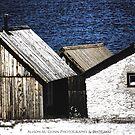 Fishing shacks in bright sun, Baltic Ocean by amgunnphotoart