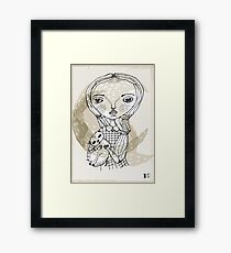 little girl with a little animal Framed Print