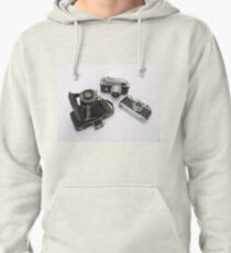 three rangefinders cameras on white background Pullover Hoodie