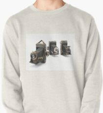 an assortment of old style film cameras        Pullover