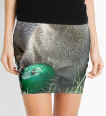Otter has a green toy Mini Skirt