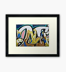 Abstract Graffiti on the textured brick wall Framed Print