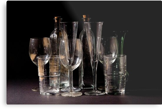 an assortment of empty cocktail, champagne and wine glasses by PhotoStock-Isra
