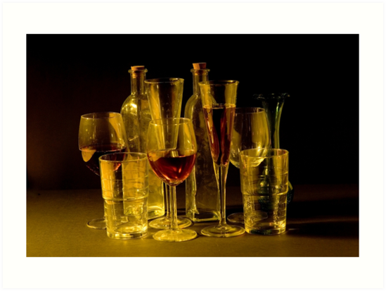 an assortment of full cocktail, champagne and wine glasses by PhotoStock-Isra