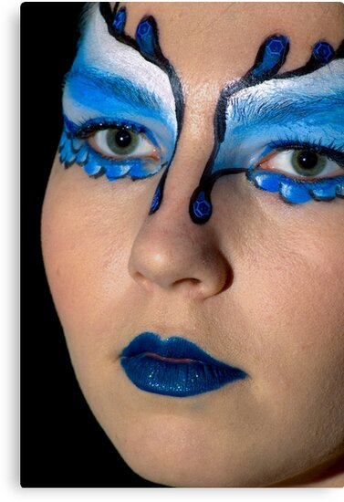 young teenage female model with blue and white elaborate make up mask on black by PhotoStock-Isra