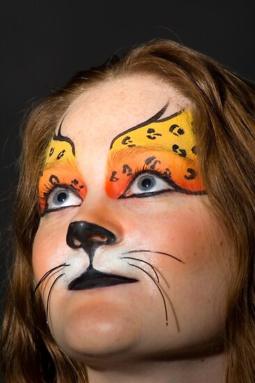 young teenage female model with elaborate tiger make up mask on black  by PhotoStock-Isra