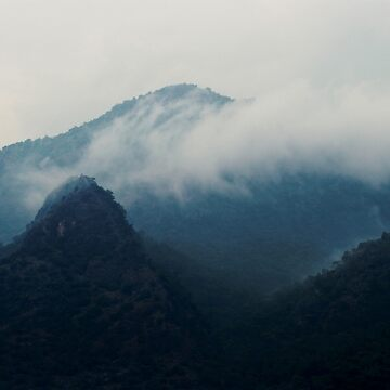 Moody Fog Over Mountain by StilleSkygger