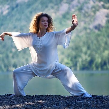 Woman in white outfit practicing Tai Chi stance by the lake in the nature art photo print by AwenArtPrints