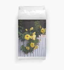 yellow flowers on the gatedoor Duvet Cover