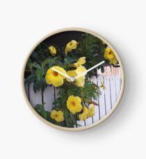 yellow flowers on the gatedoor Clock