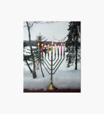 Lighted Chanukah Menorah in Snow Against Frozen Lake Art Board