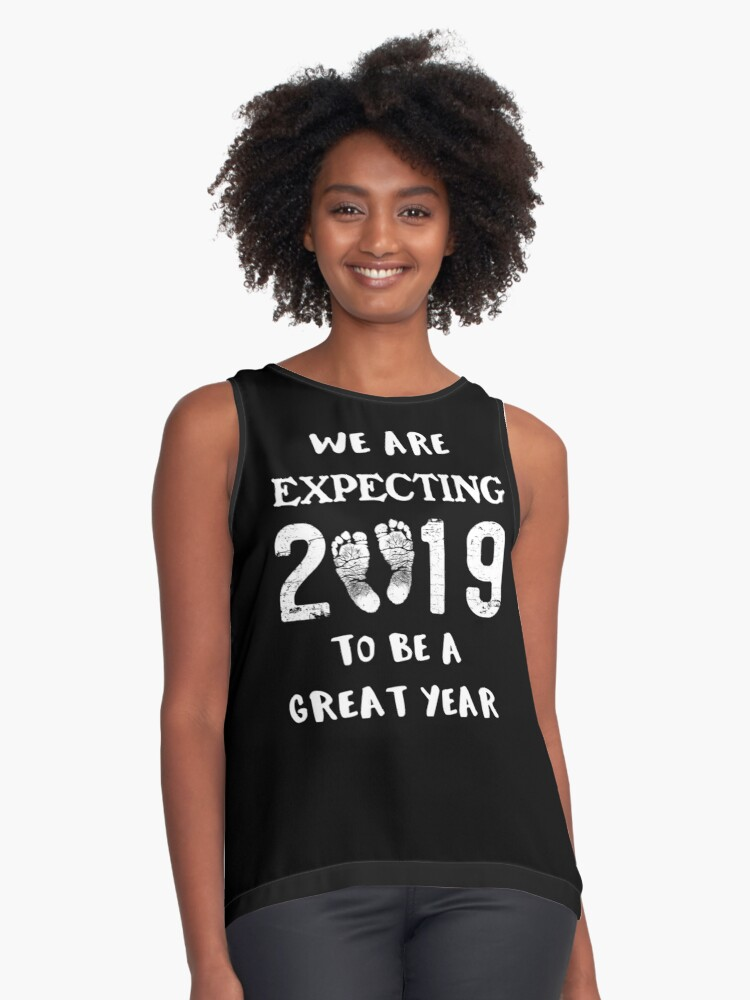 73b7a3fb7b9bf Pregnancy Reveal Baby Announcement New Year 2019 Sleeveless Top. Designed by  RiffXS