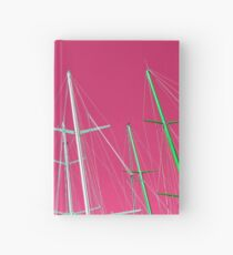Masts of yachts and sail boats with clear pink sky background Hardcover Journal