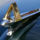 "What do I belong to!? ""Larry, I cheated and googled 1951 Hudson Hornet, – it's a series 7A, thus the gold A on the hood ornament.""  Solved by Scott Hendricks.. by Larry Llewellyn"