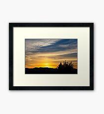 Sunset over mountains Framed Print