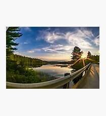 sunset looking down river with bridge  Photographic Print