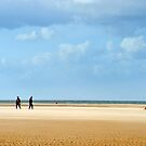 Walking the Dog on the beach, Norfolk by Richard Flint
