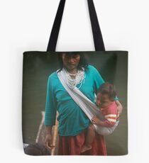 Woadani woman and grandson in dugout canoe Tote Bag