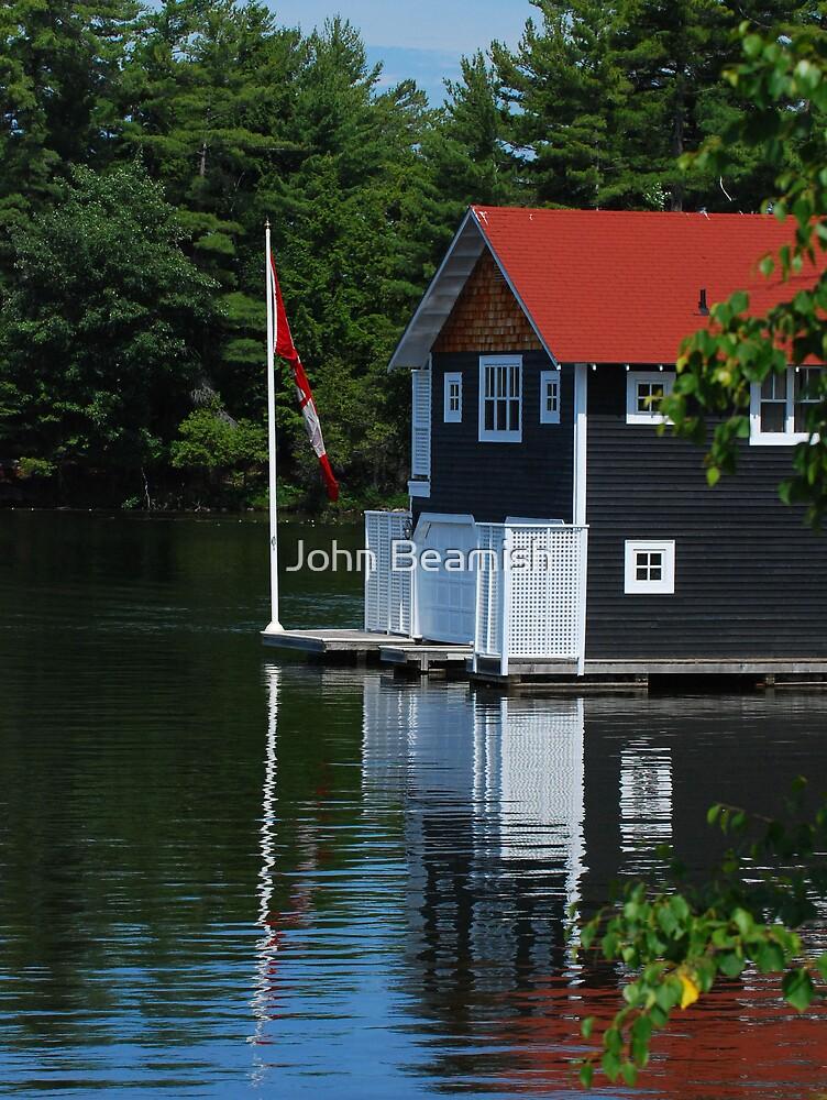 Muskoka boathouse. by John Beamish