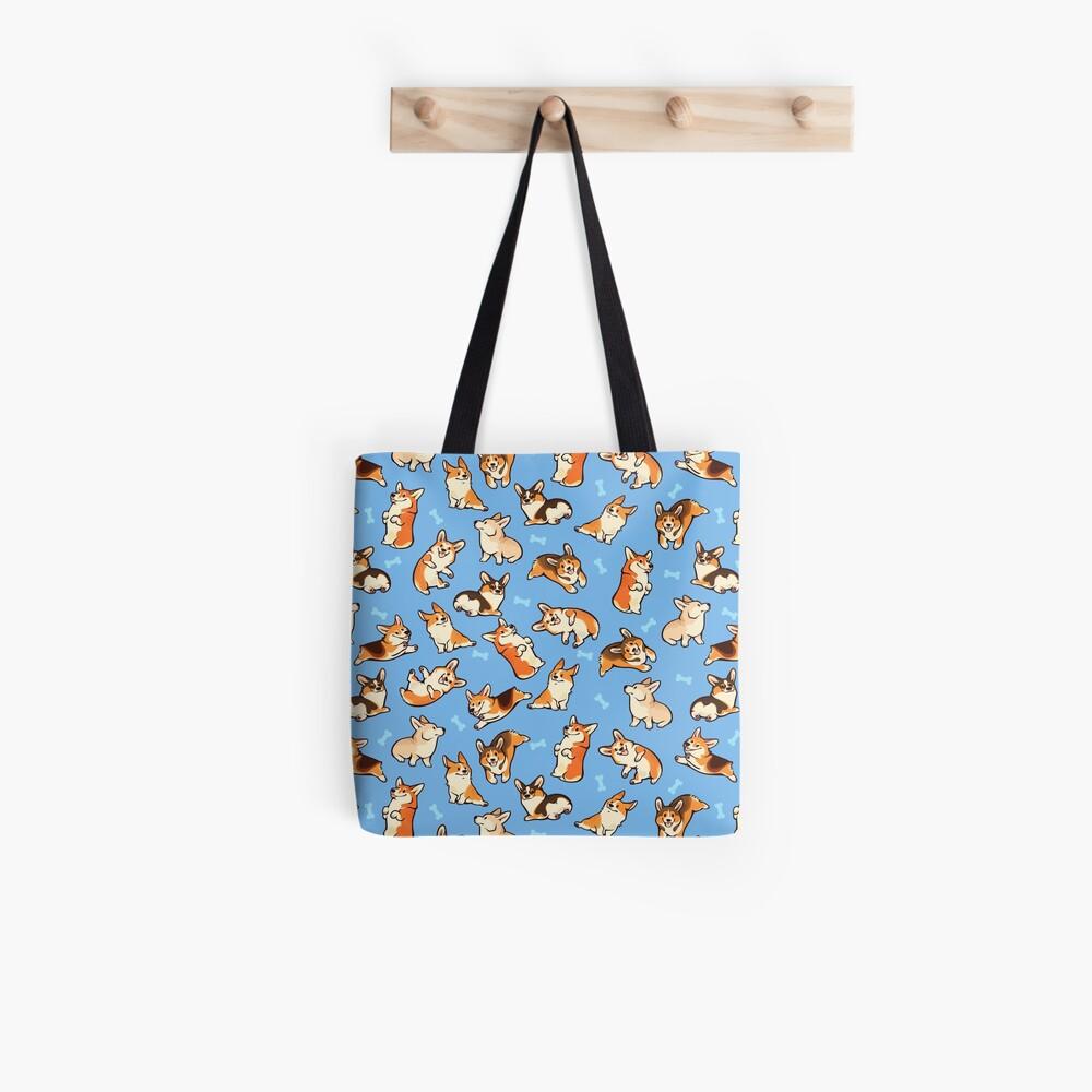 Jolly corgis in blue Tote Bag